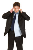 Businessman with headache holding hands at head Royalty Free Stock Image