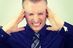 Businessman with a headache Stock Photos