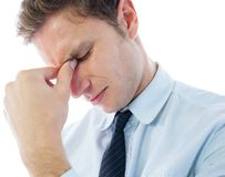 Businessman with a headache Stock Images