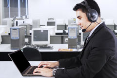 Businessman with headphone and laptop Royalty Free Stock Photos