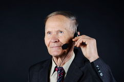 Businessman with headphones Royalty Free Stock Image