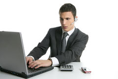 Businessman with headphones and laptop Royalty Free Stock Image