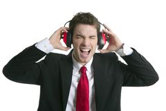 Businessman headphones noise expression gesture Royalty Free Stock Images