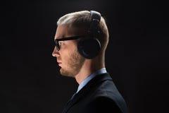Businessman in headphones Royalty Free Stock Photos