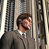 Businessman with headset. Three dimensional portrait of handsome young businessman with wireless headset; office building in background Royalty Free Stock Image