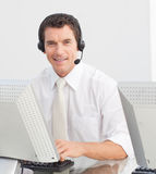 Businessman with a headset on in a call center Royalty Free Stock Photography