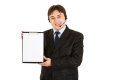 Businessman with headset holding blank clipboard Stock Image