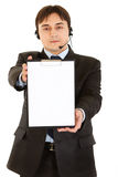 Businessman with headset holding blank clipboard Royalty Free Stock Images