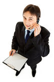 Businessman with headset holding blank clipboard Royalty Free Stock Photo