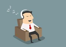 Businessman with headset listening music Stock Image
