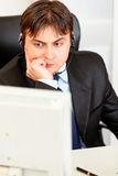 Businessman with headset looking at monitor Stock Photos