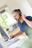 Businessman with headset on Royalty Free Stock Photos