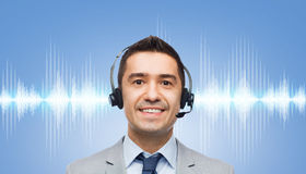 Businessman in headset over sound wave or diagram Royalty Free Stock Photography