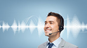 Businessman in headset over sound wave or diagram Stock Images