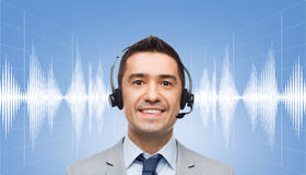Businessman in headset over sound wave or diagram Royalty Free Stock Photos
