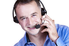 Businessman, a headset with a phone call. Royalty Free Stock Image
