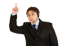 Businessman with headset pointing finger up Royalty Free Stock Image