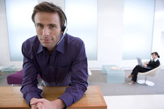 Businessman with headset, portrait Royalty Free Stock Images