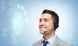 Businessman with headset and shopping trolley icon Stock Image