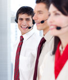 Businessman with headset on smiling at the camera Stock Photos