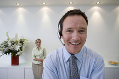 Businessman with headset, smiling, portrait Stock Photography