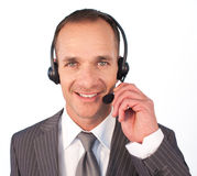 Businessman with a headset on talking Stock Photos