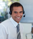 Businessman with a headset on working Royalty Free Stock Photography