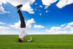Businessman headstand outdoors Royalty Free Stock Photos