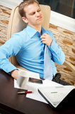 Businessman with health problems. Young businessman with health problems stock image