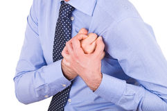 Businessman with heart attack. Stock Photos