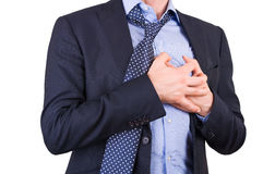 Businessman with heart attack. Royalty Free Stock Photography