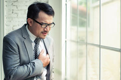 Businessman heart failure royalty free stock photos