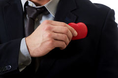 Businessman with heart model in pocket. Royalty Free Stock Image