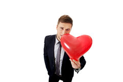 Businessman with heart shaped balloon. Royalty Free Stock Image
