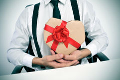 Businessman with a heart-shaped gift Stock Photography