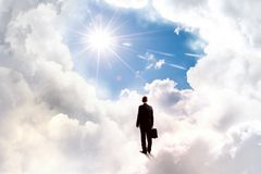 Businessman in heaven Stock Photo