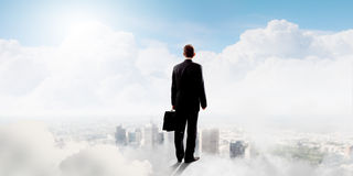 Businessman in heaven Royalty Free Stock Images