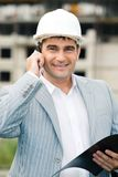 Businessman with helmet Royalty Free Stock Photos