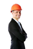 Businessman in helmet with arms folded Royalty Free Stock Images