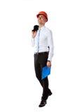 Businessman in helmet with blue folder Stock Photo