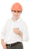 Businessman in a helmet with a cigarette. Royalty Free Stock Photos