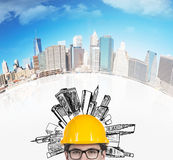 Businessman with helmet. And drawing skyscraper Royalty Free Stock Photo
