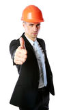 Businessman in helmet giving thumbs up Stock Photo