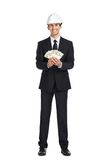 Businessman in helmet hands money Royalty Free Stock Photo