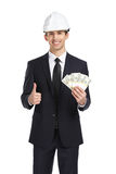 Businessman in helmet hands money and thumbs up. Isolated on white. Concept of finances and success Royalty Free Stock Photo