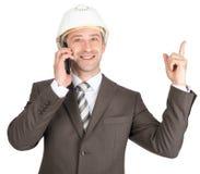 Businessman in helmet Stock Image