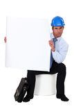 Businessman with a helmet on Stock Image