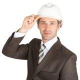 Businessman in helmet Stock Images