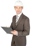 Businessman in helmet holding paper holder Royalty Free Stock Photography