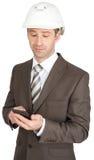 Businessman in helmet Stock Photos